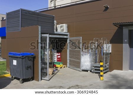 Correct modern utilization and collecting garbage for city shop landscape. Containers, steel gate and conditioners
