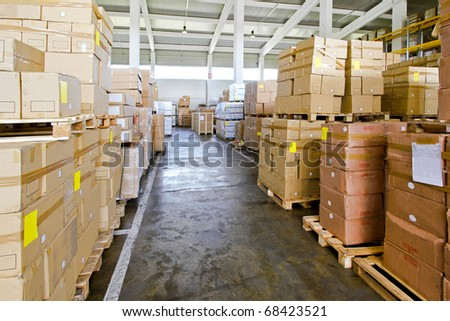 Corridor in storehouse with lot of boxes