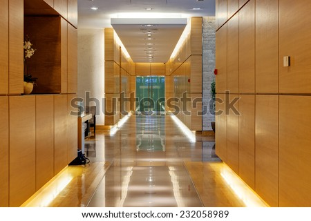 Corridor inside of modern building with wooden panels on walls - stock photo