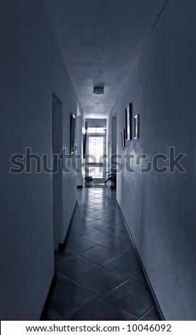corridor leading to light - stock photo