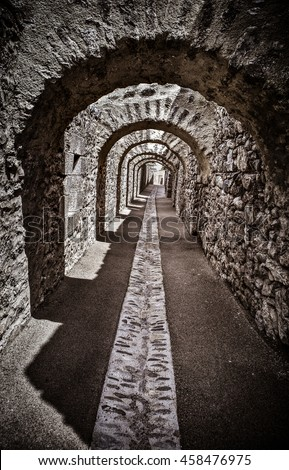 Corridor of an ancient castle. Picture with high contrast effect. - stock photo