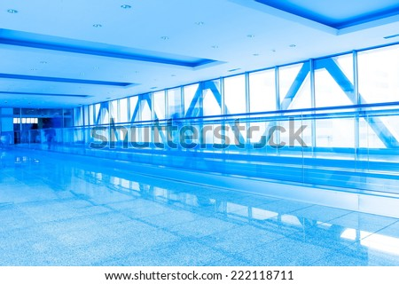 corridor structure with glass walls in blue - stock photo