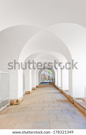 corridor with a ceiling in the form of arches in white - stock photo