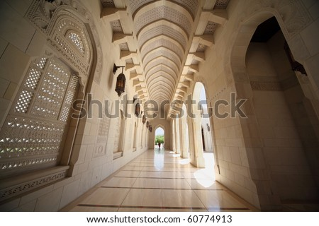 corridor with arcs inside Grand Mosque in Oman. Wide Angle. - stock photo