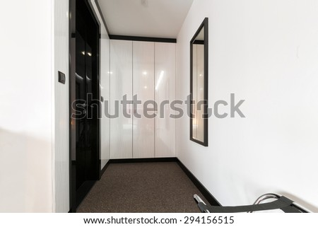 Corridor with closet in hotel room