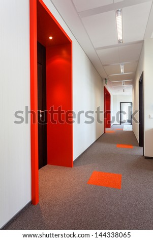 Corridor with colorful floor and door frames - stock photo
