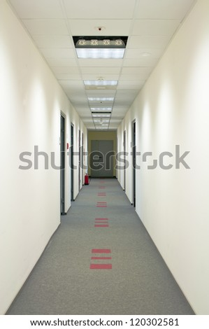corridor with gray carpet and white wall - stock photo