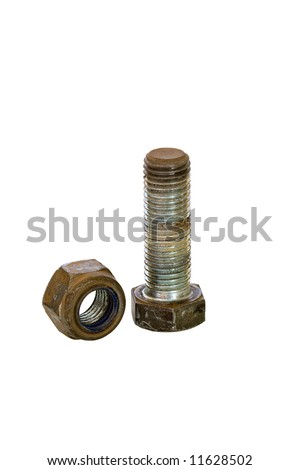 Corroded used galvanised bolt upright and loose locknut against white background