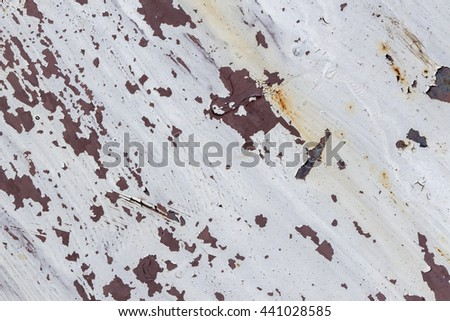 Corroded white metal background. Rusted white painted metal wall. Rusty metal background with streaks of rust. Rust stains. The metal surface rusted spots. rust corrosion.