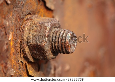 Corrosive rusted bolt with nut. Grunge industrial construction close up. - stock photo