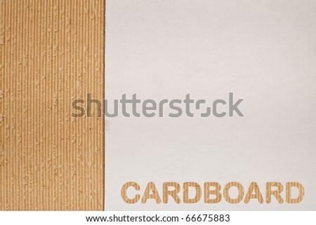 Corrugated cardboard background with copy space and fine texture - stock photo