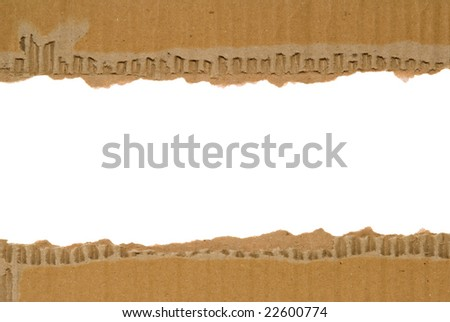 Corrugated cardboard border with a white area for text. - stock photo