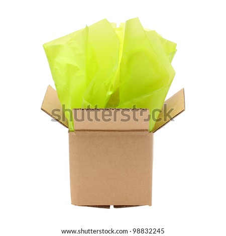 Corrugated cardboard box with tissue paper isolated on white background - stock photo