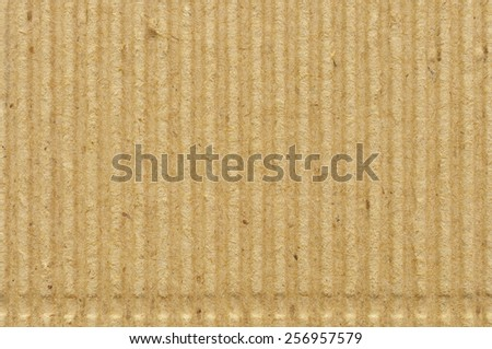 Corrugated cardboard goffer paper texture rough old recycled goffered textured blank empty grunge copy space background aged grungy macro closeup taupe brown yellow beige horizontal vintage pattern - stock photo