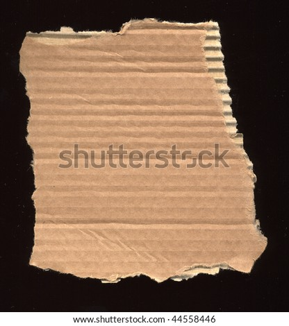 corrugated cardboard over black background
