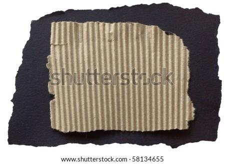 corrugated cardboard paper sheet on black paper - stock photo