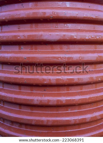 corrugated drainage pipe made ??of plastic, close up view - stock photo