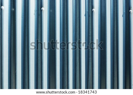 Corrugated metal sheet fence with natural grainy texture - stock photo