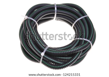 Corrugated pipe for electrical cables coiled in a circle isolated on white background - stock photo