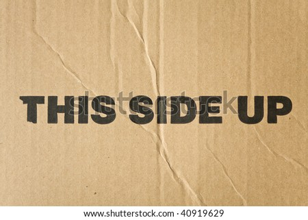 Corrugated recycled brown carton with bold black imprint - stock photo