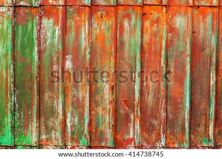 Corrugated Rusty Colored Metal Cracked Paint Grunge Texture - stock photo