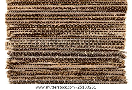 Corrugated stacked cardboard isolated on white background. - stock photo