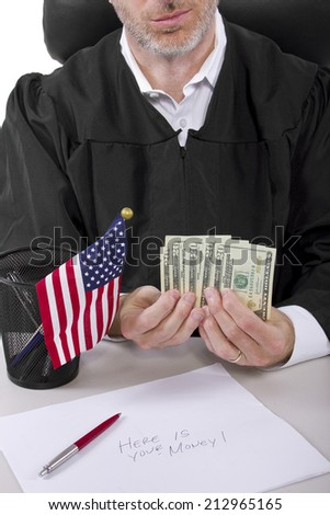 corrupt american judge taking money as a bribe or stealing - stock photo