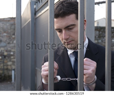 corrupted manager going in jail with handcuffs - stock photo