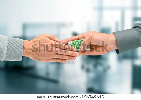 corruption concept - businessman giving a bribe - stock photo