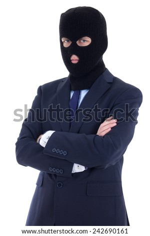 corruption concept - man in business suit and black mask isolated on white background - stock photo