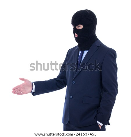 corruption concept - man in business suit and black mask with hand extended to handshake isolated on white background - stock photo