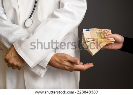Corruption in Health Care Industry, Doctor receiving large amount of Euro banknotes as a bribe. - stock photo
