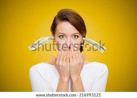 Corruption. It will keep me quiet. Bribery concept in politics, business, diplomacy. Corporate businesswoman plugs her ears with dollar banknotes, bills, covers her mouth, isolated yellow background  - stock photo