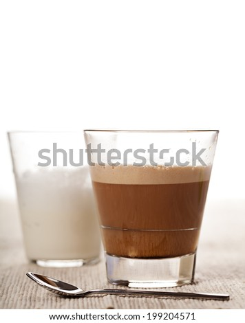 Cortado coffee drink in glass