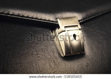Coseup of lock on leather business case - stock photo