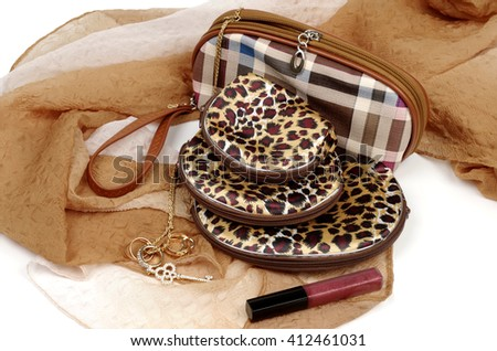 Cosmetic bag and tools for make-up on beige kerchief