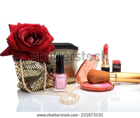Cosmetic bag, makeup items, perfume and flowers in still life - stock photo
