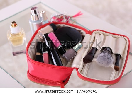 Cosmetic bag on table on light background - stock photo