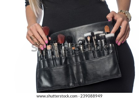 cosmetic bag with brush - stock photo