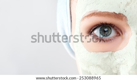 cosmetic beauty mask on the face and eyes close up - stock photo