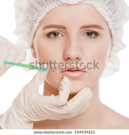 Cosmetic botox injection in the female face. Lips and cheek zone. Isolated on white