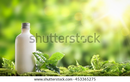 cosmetic bottle on nature background - stock photo