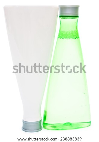 Cosmetic bottles (green and white) isolated copy space - stock photo