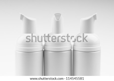 cosmetic bottles isolated on white - stock photo
