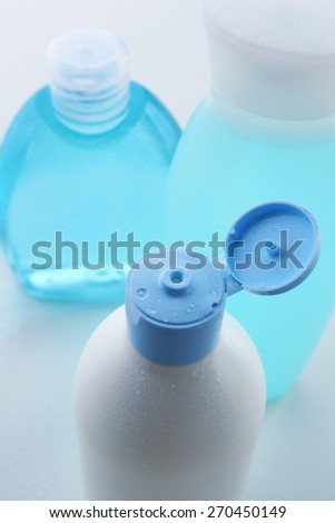 Cosmetic bottles isolated on white - stock photo