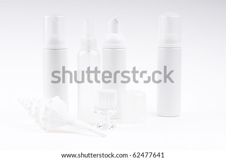 cosmetic bottles with brush and shell - stock photo