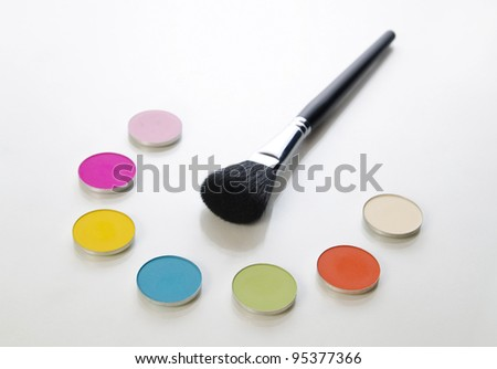 cosmetic brush and different colors - stock photo