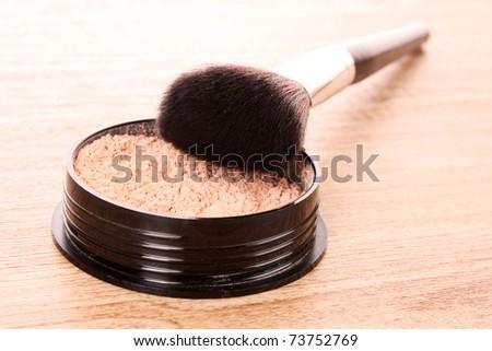 cosmetic brush and powder - stock photo