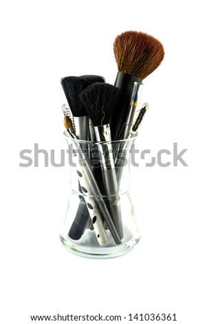 cosmetic brushes in glass isolated on white background