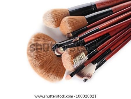 Cosmetic brushes on a white background